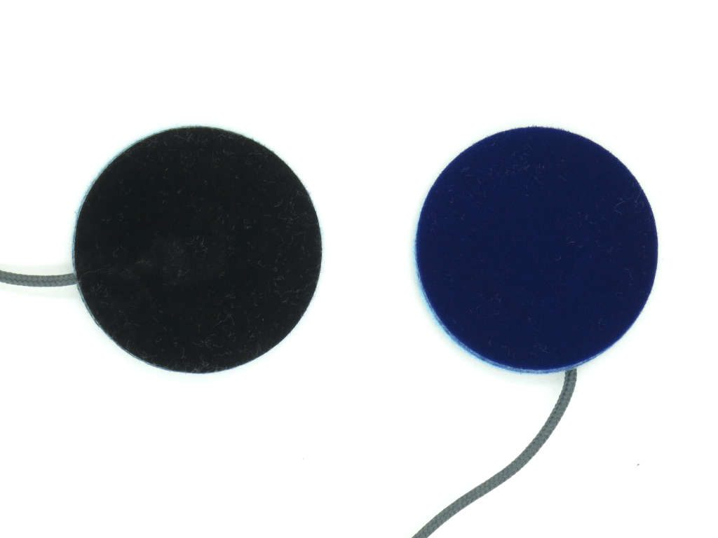 Cozyphones speaker inserts: The black side faces the fleece.