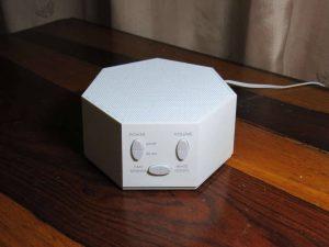 White-noise-machine-on-night-stand