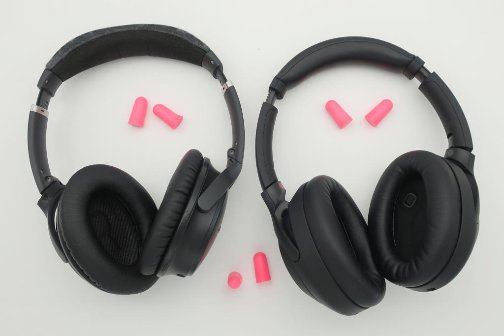 How effective is wearing noise cancelling headphones over earplugs?